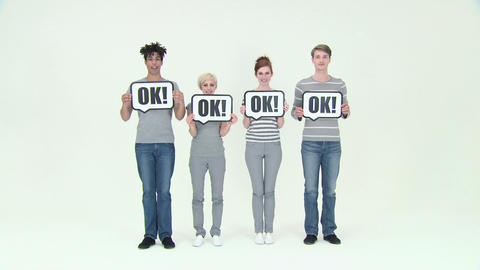 Time lapse of four people with signs that say ok Stock Video Footage