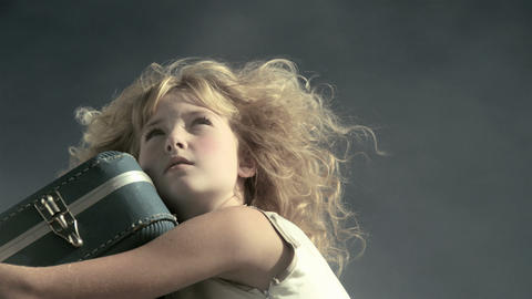Girl with suitcase, spinning across screen Stock Video Footage