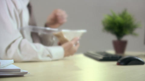 Office worker eating sandwich Stock Video Footage