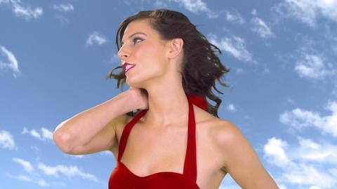 Beautiful young woman against sky background Stock Video Footage