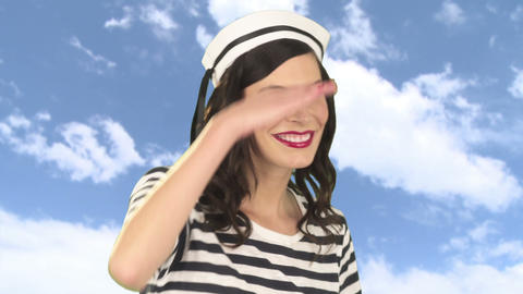 Young woman in sailor cap, looking away and posing Stock Video Footage