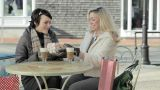 Woman giving gift to friend at cafe Footage