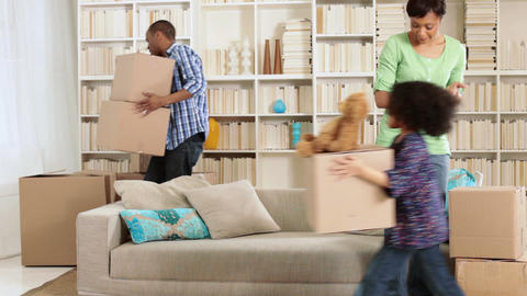 Family moving boxes and sitting on sofa Stock Video Footage