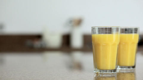 Oranges and orange juice on kitchen counter Stock Video Footage
