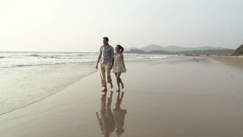 Couple walking by sea Stock Video Footage