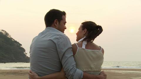 Couple on beach at sunset Stock Video Footage