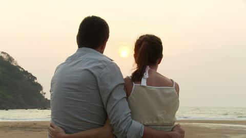 Couple on beach at sunset Stock Video Footage