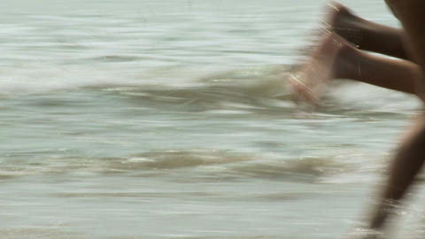 Couple running in sea Stock Video Footage