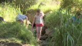 Children walking over rocks in river Footage