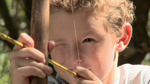 Boy with bow and arrow Stock Video Footage