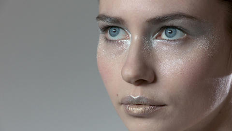 Young woman with silver make up on face Stock Video Footage