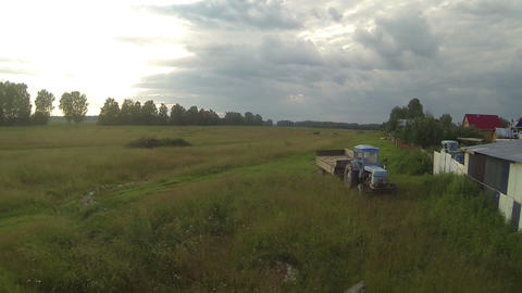 Aerial shot. Storm is coming to village - country side, old abandoned tractor, a Footage