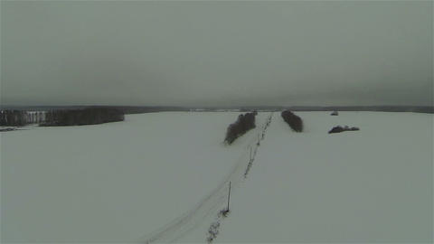 Aerial view of snow field and road in russian country side, winter Footage