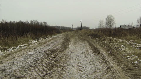 Aerial view of frozen dirty road in country side, first snow in russia Footage