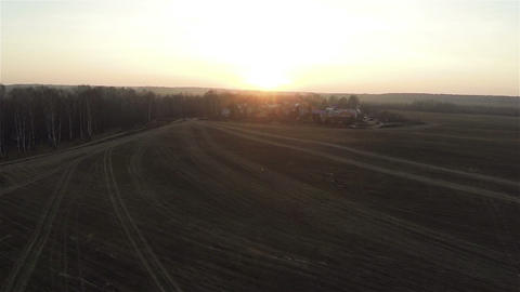 Aerial view of field roads at sunset near village in the forest, autumn, russian Live Action