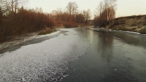 Aerial view of autumn icy river at sunset afterglow, russia Footage