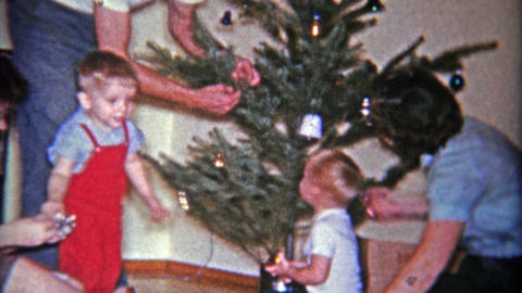 1961: Decorating a sad charlie brown style Christmas tree in a coffee can Footage