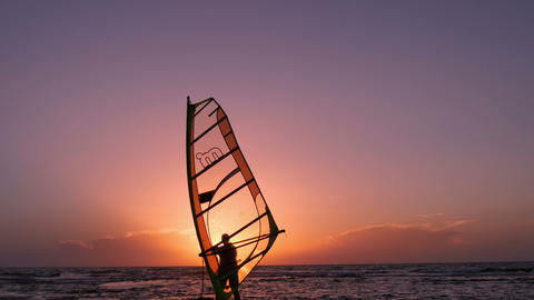 Windsurfing. Man preparing to put to sea Footage