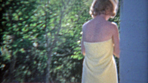 1963: Catching thin blonde wife in just a towel and in running athletic clothes Footage