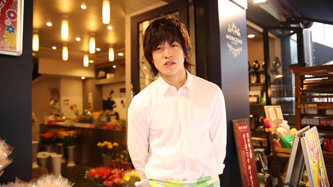 Handsome young man at flower shop Footage