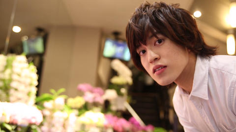 Handsome man at flower shop Footage