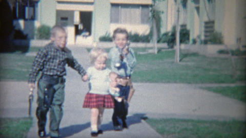 1964: Armed children with toy guns holstered shooting and laughing Footage
