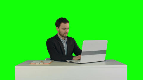 Young businessman concentrating on working with laptop computer on a Green Scree Footage
