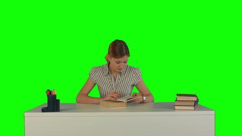 Beautiful female student read book on a Green Screen Footage
