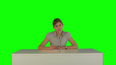 Young girl sitting in classroom at lecture and listening teacher on a Green Scre Footage