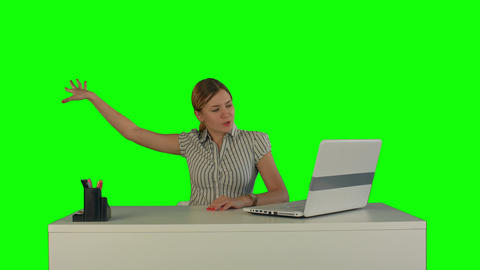 Woman is working on the laptop on a Green Screen Footage
