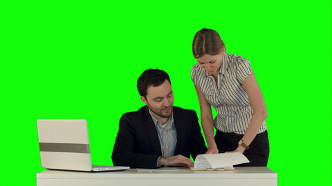 Businesswoman standing in the office presenting a document to her boss sand sign Footage