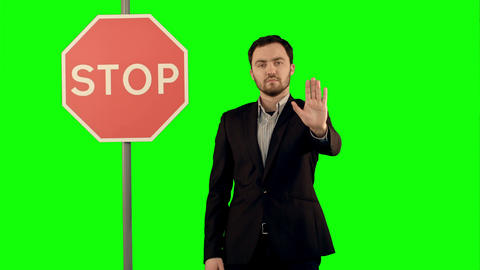 Businessman standing near a stop sign on laptop on a Green Screen, Chroma Key Footage