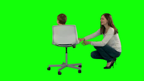 Mother and boy play game on a Green Screen Footage