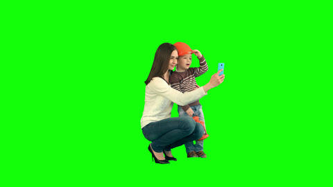 Boy taking a selfie with her mother on a Green Screen Footage