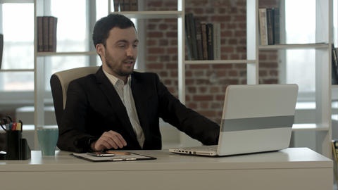Businessman on video conference with his colleague in office job Footage