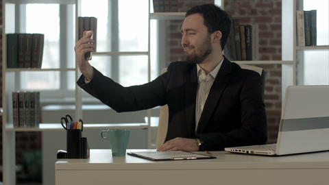 Selfie businessman taking pictures in the office Footage