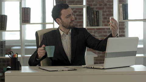 Businessman using smartphone to take picture of himself Footage