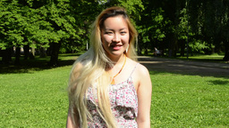 young attractive happy asian woman turns over and smiles... Stock Video Footage