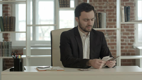 Businessman Count Pack Of Money In Office stock footage