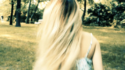 young attractive woman runs in the park with loose hair - steadicam - filter Footage