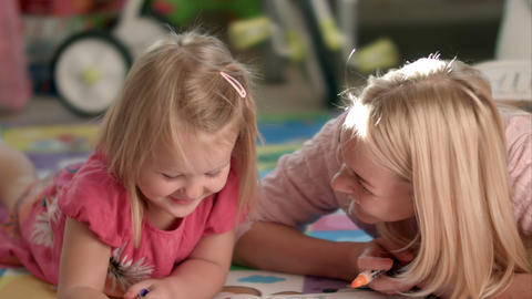Mother and daughter writing together Footage