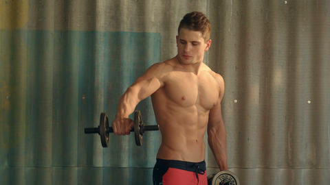 Strong and muscular guy with dumbbell Footage