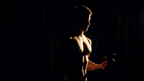 bodybuilder posing. Handsome power athletic guy male. Fitness muscular body on b Footage