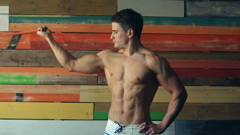 Very power athletic guy bodybuilder Footage