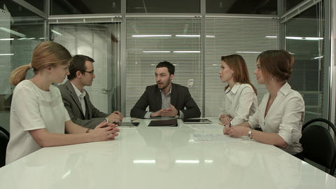 Business People Having Board Meeting In Modern Office Footage