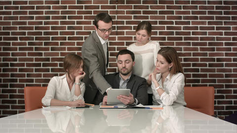 Businesspeople With Digital Tablet Having Meeting In Office Footage