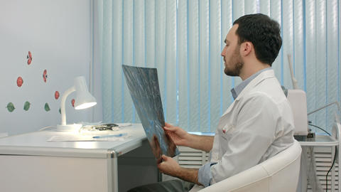 Doctor looking at the x-ray picture of lungs in hospital Footage