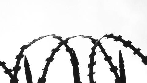 Wire Barricade Against A White Hi-key Background stock footage