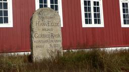 Greenland small town Qaqortoq 062 big gravestone on the overgrown churchyard Footage