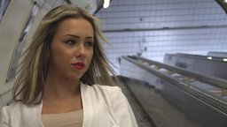 young attractive blonde woman travels on the escalator in the subway Footage